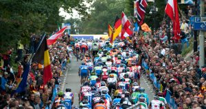 A colorful crowd of thousands cheers the peloton up the Cauburg at the Road World Championships. Photo: Casey B. Gibson | www.cbgphoto.com